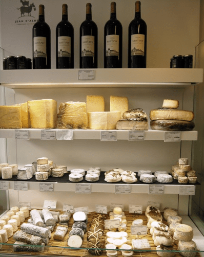 Cheeses and wines for sale in a shop in Bordeaux, France