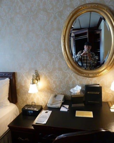 Reporter Bone (see mirror) meets his stateroom on the American Empress.
