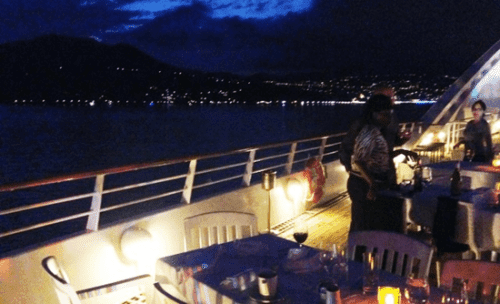 A sundeck dinner on Star Breeze off the coast of Italy